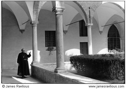 Priest in a cloister, San Gimigniano, Italy, 1978